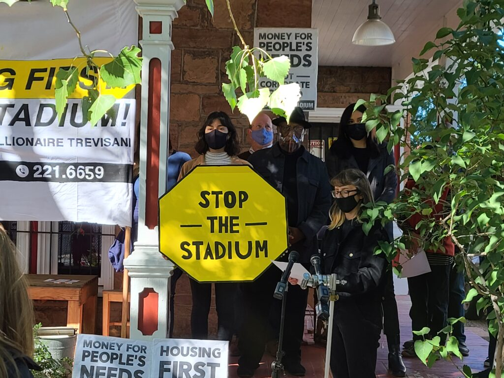 Stop the Stadium organizers stand on a front porch giving speeches Tuesday Oct. 13, 2021.